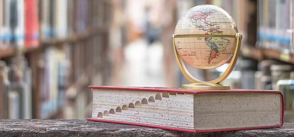 small globe sits on a dictionary