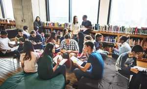 high school students studying in a school library