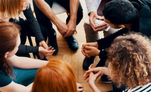 group of students talking in a support group